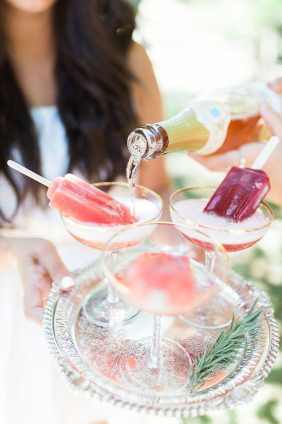 Bring in a popsicle stand and offer lots of bubbly for guests to make this fun and festive dessert. Photography: Ainsley Rose.