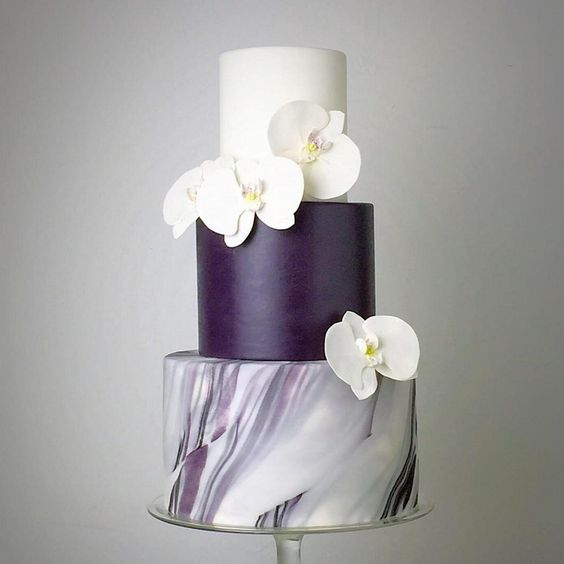 A striking purple marble wedding cake with gorgeous sugar flowers. Wedding cake inspiration.