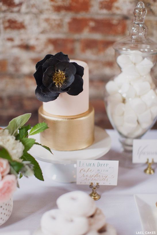 If you don't dare to go full blue, how about a raspberry filled gold and white cake with a gorgeous blue flower? Lael Cakes.