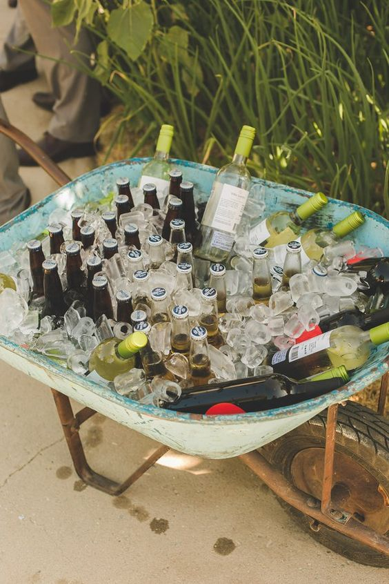 A great way to save on your wedding bar. Place a couple of these wheelbarrows filled with beverages on each side of your food truck.