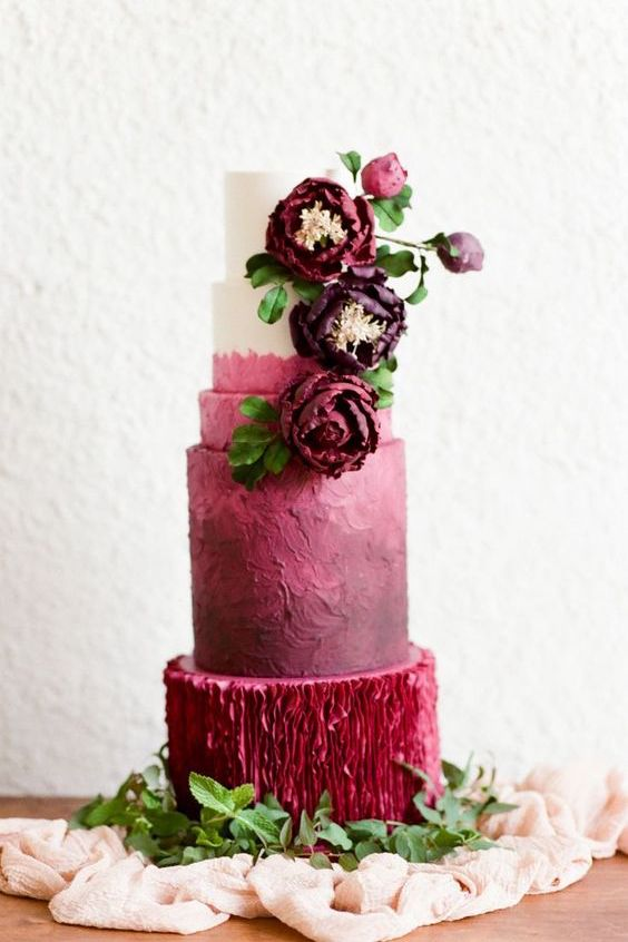 Add a bit of texture to the bottom tier of this scarlet wedding cake and wow your guests! Photographer: Tamara Gruner Photography.