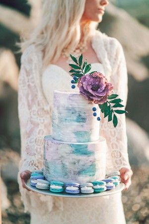 Surround your cake with macaroons in seaside-inspired colors. Wedding photographer: London Light Photography.