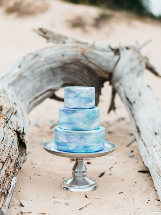Simplicity at its best on this three tier watercolor beach wedding cake.
