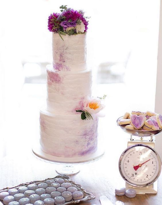 Soft mauves adorn this whimsical winter beach wedding cake.