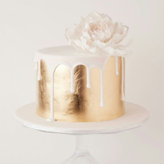Simple and luxurious gold leaf and white chocolate drip-effect cake.