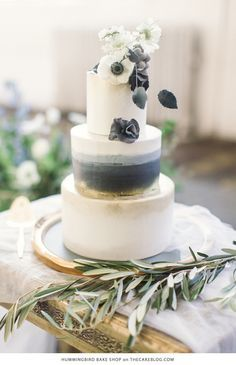 Another stunning watercolor beach wedding cake confection in marine blue, sky and white with highlights in gold foil and sweet poppies. With a cake like this, I wouldn't mind getting married in the winter! Design by Hummingbird Bake Shop.