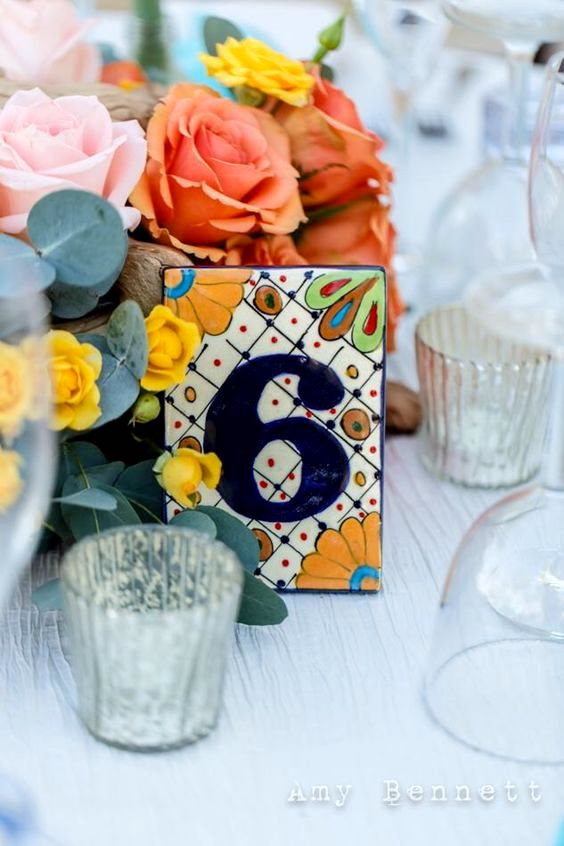 Unique table number ideas: hand painted talavera tiles.