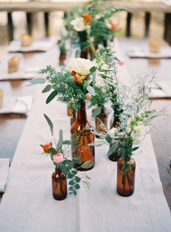 Bottles, greenery and a few flowers can turn your wedding into a Pinterest-worthy event without breaking the budget.