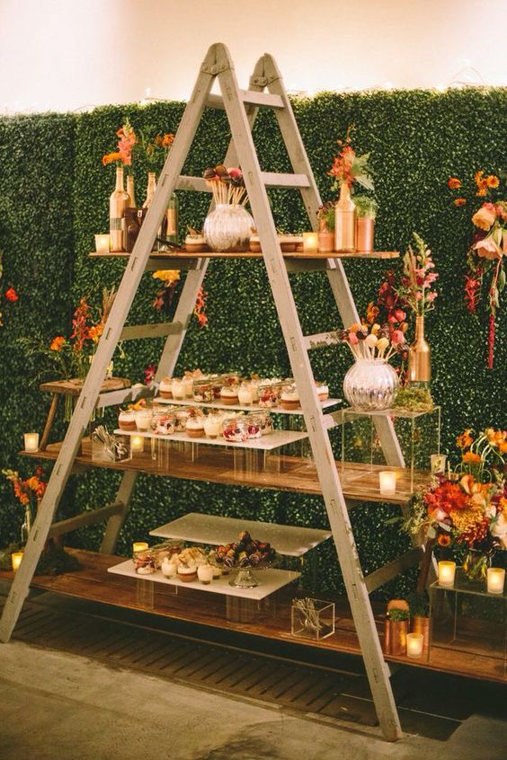 Set up your wedding dessert table on a ladder with a few wooden boards for an original and affordable presentation.