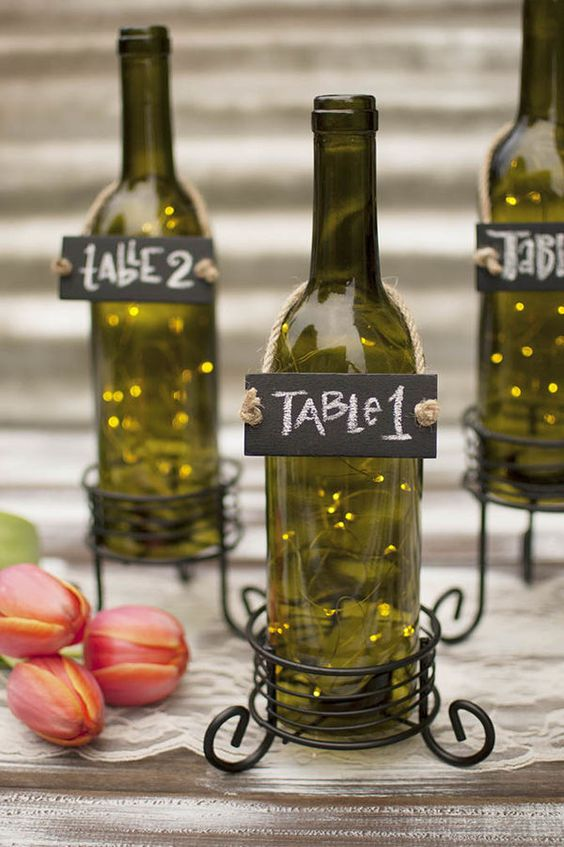 Make your decor work for you as table numbers, centerpieces and fairy lights.