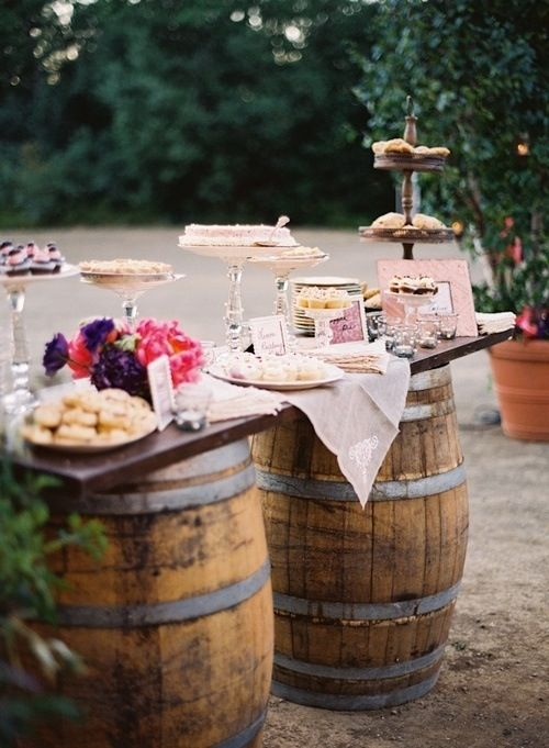 A not so improvised dessert table packed full of shabby chic and rustic details for a garden wedding.