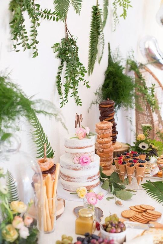 Dessert tables for summer weddings. For a greenery wedding add ferns and leaves to the wall and table and a few pops of colorful flowers.