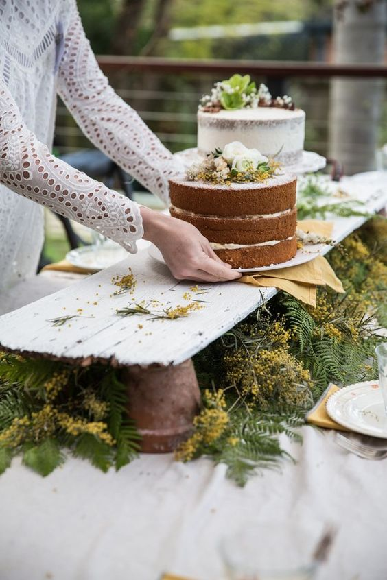 Cool way to do a dessert table...raised up with greens underneath.