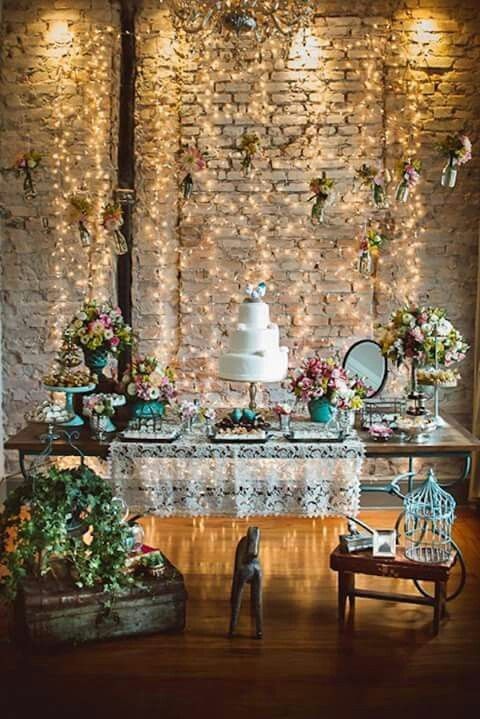 Add some glam to you indoor wedding by placing a lighted backdrop behind your wedding dessert table.