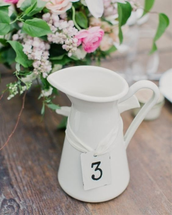 Delightful wedding hack for an original centerpiece/table number combo.