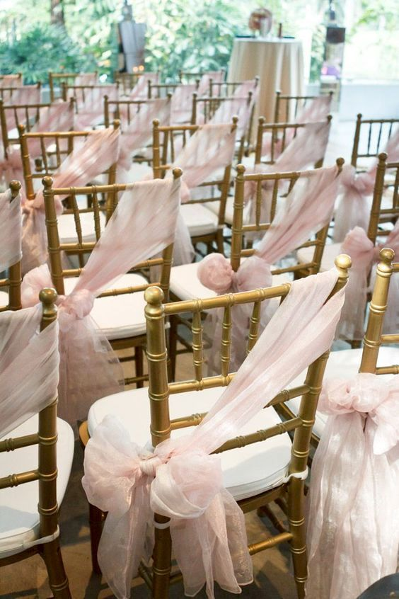 Grab some tulle and decorate your ceremony or reception chairs.