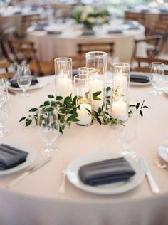 A whimsical and trendy rustic centerpiece that fits most wedding themes.