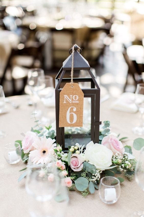 Pink and white rustic chic centerpiece and table number.