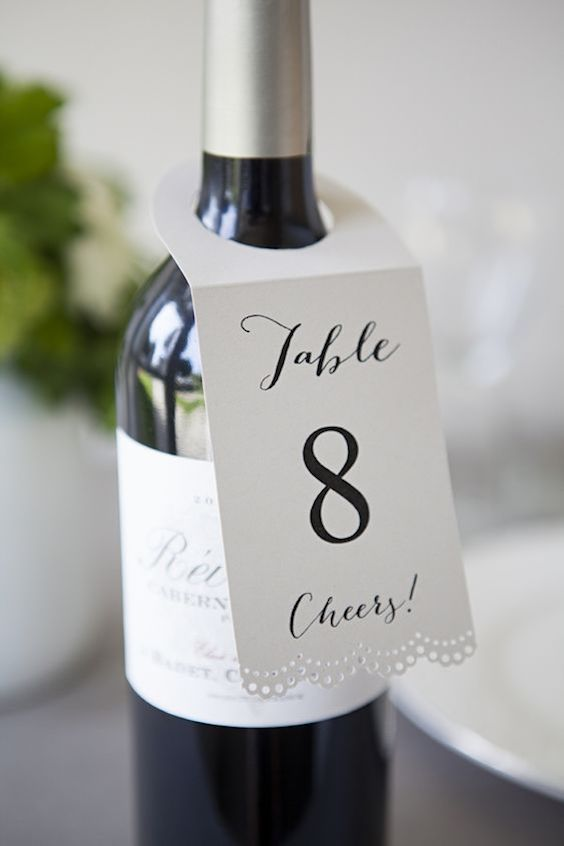 Lovely and simple wine bottle hang tag table numbers.