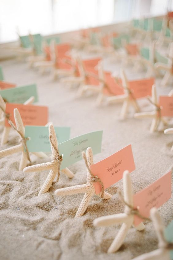 Starfish escort cards in aqua & coral for a beach wedding. Photographer: kml photography.