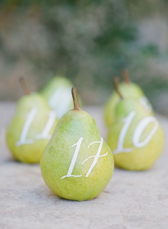 Unique table number ideas incorporating fruits. Captured by Jose Villa, Fine Art Weddings at Sunstone Villa Wedding.