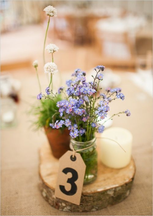 How about a table number tied to a mason jar? Photography by Green Photographic.
