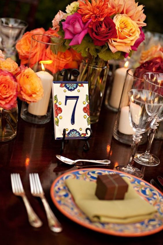 Vibrant table number with ceramic address tiles.