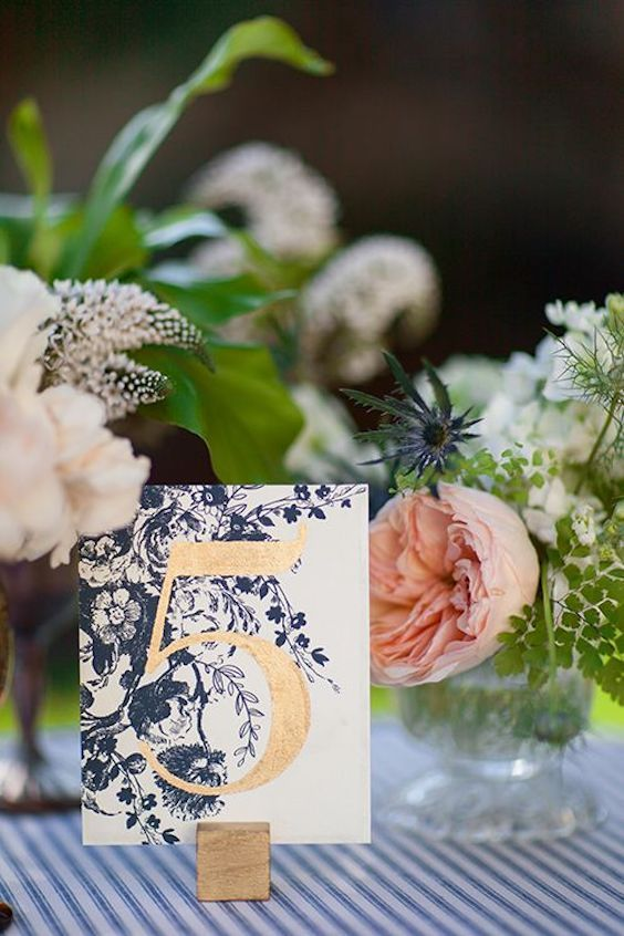 A gold and navy vintage inspired table number.