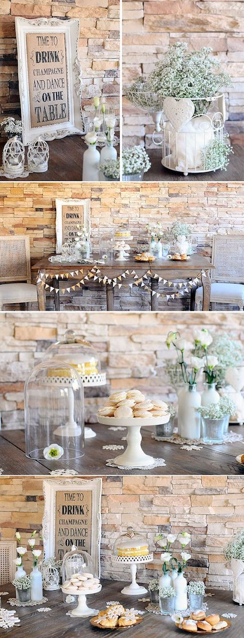 Achieve a vintage rustic dessert table look with baby's breath and white bird cages.