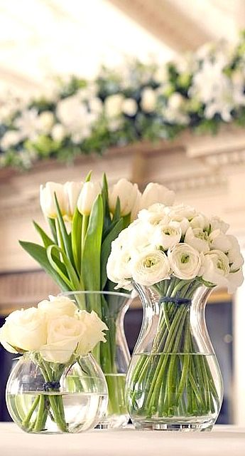 So beautiful yet so simple and elegant. White floral centerpieces.
