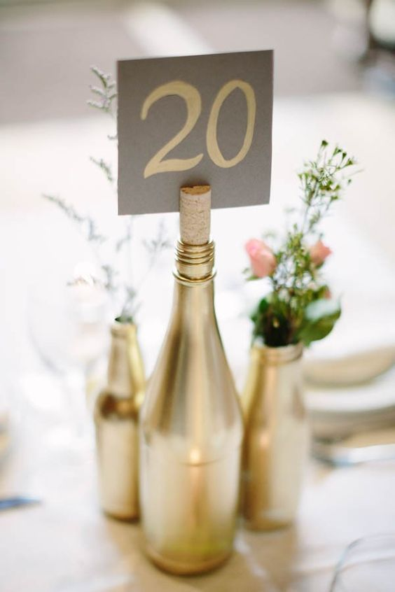 Painted wine bottle seating card holder. Dan Stewart Photography.