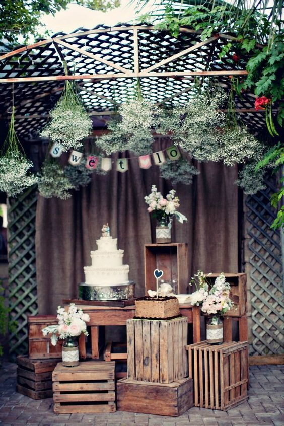 Rustic vintage cake display with crates.