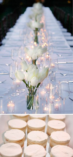 Tablecloths and white tulips accompanied by confectioners sugar-covered desserts.