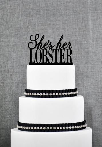 "Simple and decorated with jewelry and an adorable ""She's Her Lobster"" cake topper."
