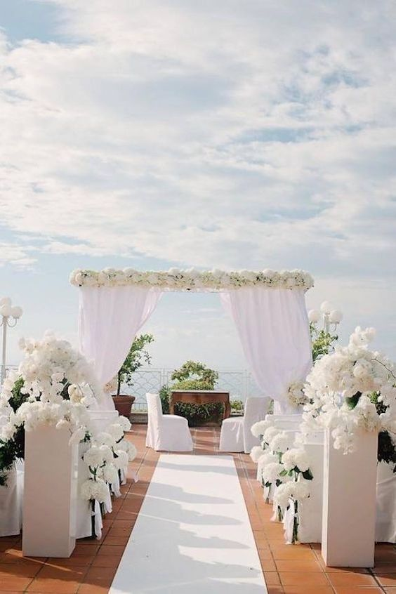 Perfect white wedding ideas add a pop of your favorite color paradise in white a little greenery and let nature frame your all white wedding junglespirit Choice Image