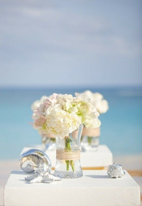 Simple hydrangea centerpiece for a beach white wedding.