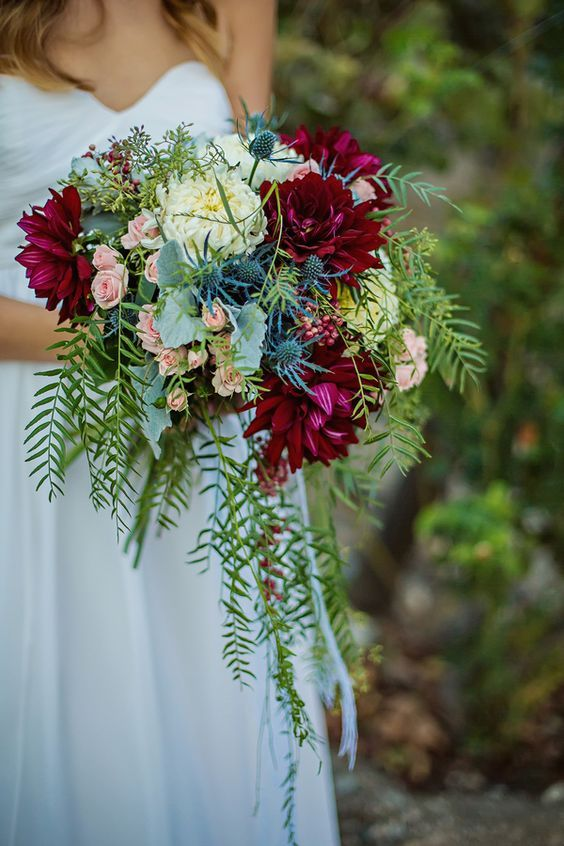 Wine, red, and dusty blue bridal bouquet at a California fall wedding. Photo: Michelle Peterson Photography.