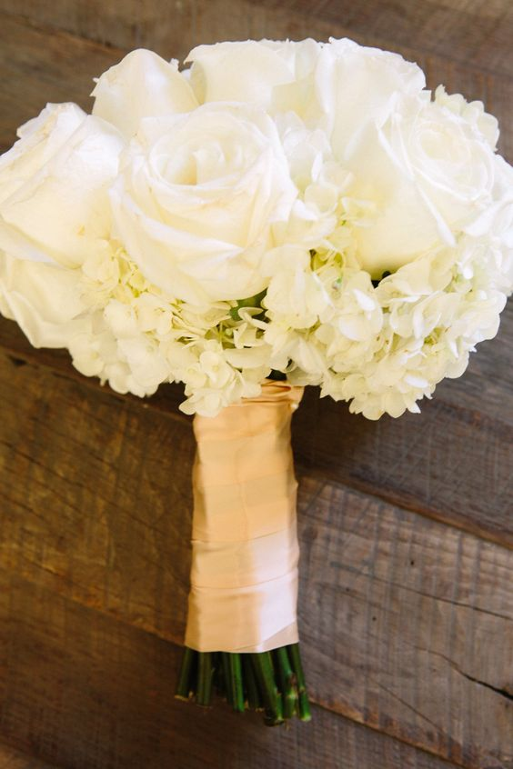 Hydrangeas and Polo Roses for bridesmaid bouquets. If you prefer to go all white use a white satin wrap instead of the gold one.