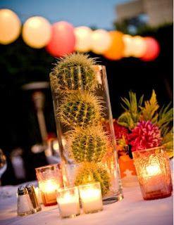Rodea tu centro de mesa con velas en pequeñas briseras.