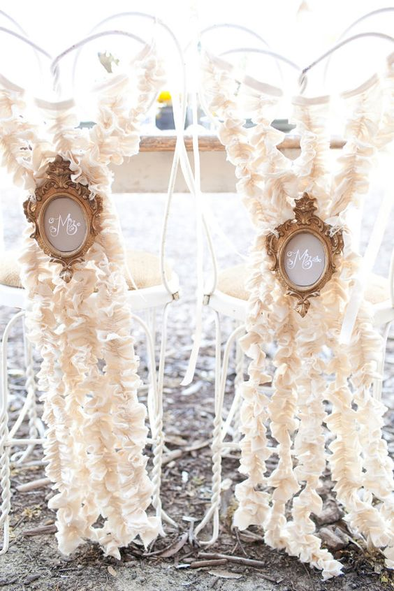 Add some ruffles to your chairs and a vintage medallion for the sweetheart's table.