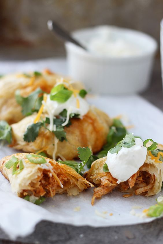 Delight your guests with chicken enchilada empanadas. Yum! Recipe: cookingforkeeps.