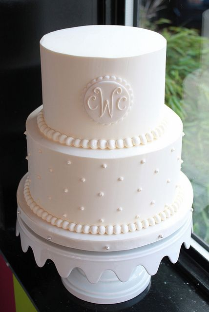 A twist on the classic wedding cake, just two tiers! Monogrammed vintage wedding cakes by Whipped Bakeshop.