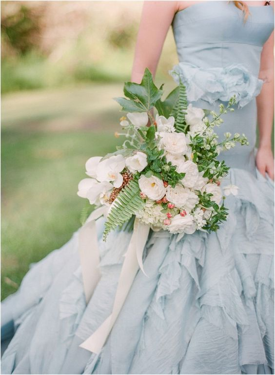 A dusty blue wedding dress will contrast against the green of the vineyard. Photo: Blush Wedding Photography.