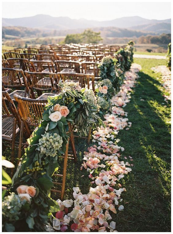 Greenery and roses aisle decor.