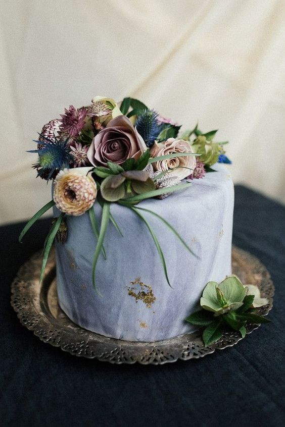 Let's travel to the world of vintage cakes. Single tier hand painted cake crowned with wildflowers and roses.