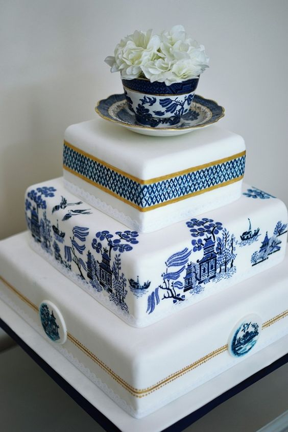Hand painted in Chinese porcelain motif. Love the tea cup cake topper.