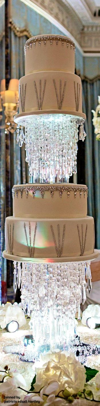 This five-tiered cake stood six feet tall and had over 4,000 Swarovski crystals!