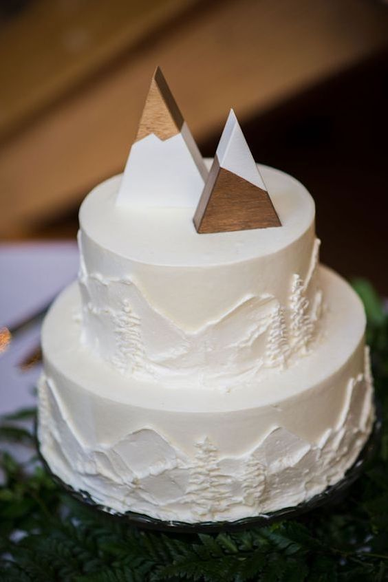 Simple and original mountain destination wedding cake.