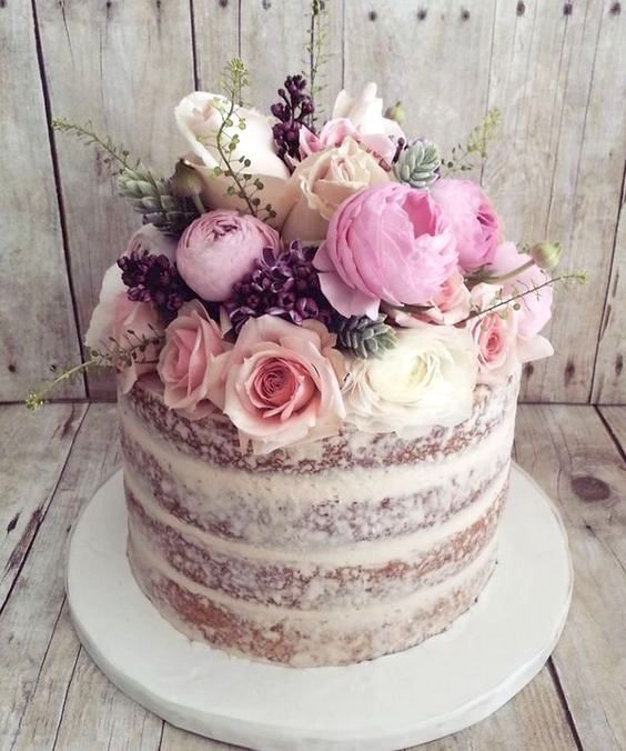 Roses and baby's breath featured on this naked wedding cake.