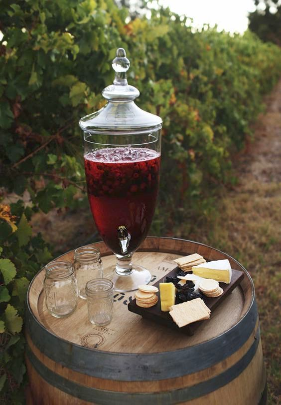 A wine and cheese barrel makes for an original vineyard wedding idea.